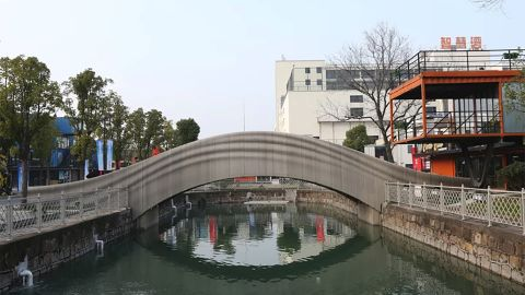 """A team led by Xu Weiguo at Tsinghua University's School of Architecture completed the world's longest <a href=""""http://news.tsinghua.edu.cn/publish/thunews/9648/2019/20190114085400082963331/20190114085400082963331_.html"""" target=""""_blank"""" target=""""_blank"""">3D-printed concrete bridge</a> in Shanghai."""