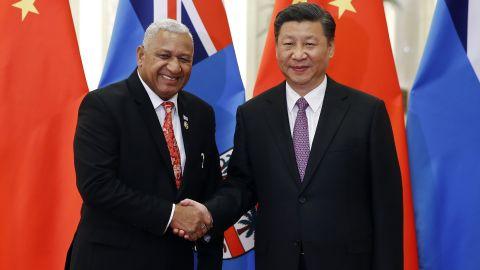 Fiji's Prime Minister Josaia Voreqe Bainimarama shakes hands with Chinese President Xi Jinping. Bainimarama has moved Fiji closer to Beijing.