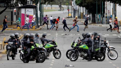 Police secure an area in Caracas on January 23.