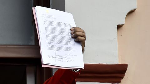 """Maduro, speaking to a crowd of supporters at the Miraflores Palace in Caracas, holds up a document that says his government is breaking off diplomatic ties with the United States. """"We cannot accept the invasive policies of the empire, the United States, the policies of Donald Trump,"""" he said to cheers from the crowd on January 23. """"Venezuela is a land of liberators."""""""