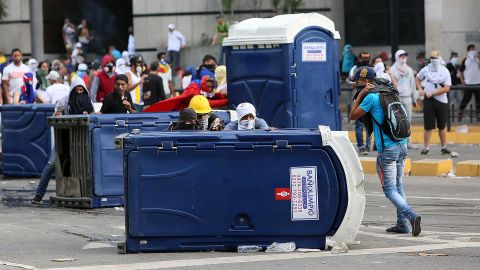 Demonstrators in Caracas protest Maduro's government.