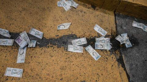 Venezuelan banknotes were thrown on the ground during the Maduro protests on January 23.