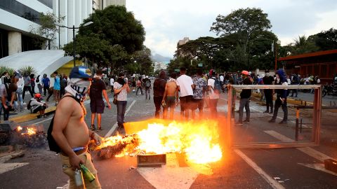 A fire burns during a protest Wednesday in Caracas against the government of Nicolas Maduro.