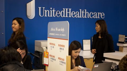 Representatives speak with customers at a UnitedHealthcare store in the Queens borough of New York, U.S., on Monday, Jan. 14, 2013. The experiment to sell health insurance to consumers in retail stores by UnitedHealth Group Inc., the biggest U.S. medical insurer, is designed to help the company compete in anticipation of sweeping changes under the new health-care law. Photographer: Michael Nagle/Bloomberg via Getty Images