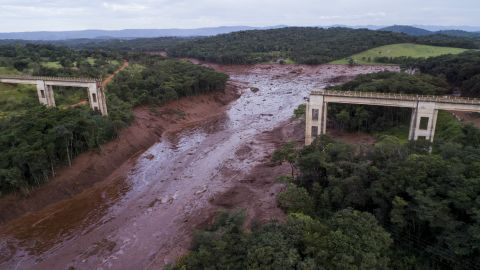 An aerial view shows a collapsed bridge after flooding from a breached dam Friday in southeast Brazil.