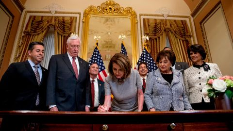 House Speaker Nancy Pelosi signs the deal to reopen the government on January 25. Democrats insisted throughout the shutdown that Trump should sign a measure to reopen the government before any border security negotiations could begin.