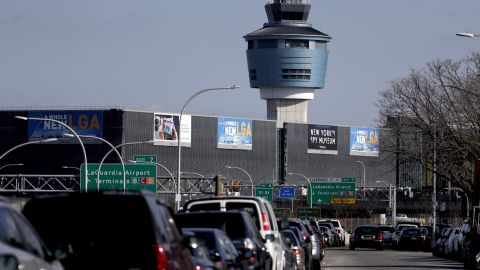 """The air traffic control tower at New York's LaGuardia Airport on January 25. The Federal Aviation Administration reported delays in air travel because of a """"slight increase in sick leave"""" at two East Coast air traffic control facilities."""