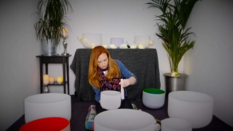 Smith uses singing bowls to create relaxing sounds during sound bath sessions.