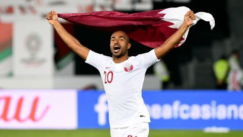 Qatar's midfielder Ali Yahya celebrates the win with the national flag during the 2019 AFC Asian Cup quarter-final football match between South Korea and Qatar at Zayed Sports City in Abu Dhabi on January 25, 2019. (Photo by Roslan RAHMAN / AFP)        (Photo credit should read ROSLAN RAHMAN/AFP/Getty Images)