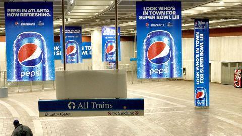 Pepsi ads blanket Atlanta's downtown MARTA station.