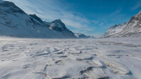 BAFFIN ISLAND, CANADA - APRIL 16:  Mountains surround the frozen Weasel River through Akshayuk Pass, in Auyuittuq National Park on April 16, 2017 on Baffin Island, Canada. (Photo by Christopher Morris - Corbis/Getty Images)