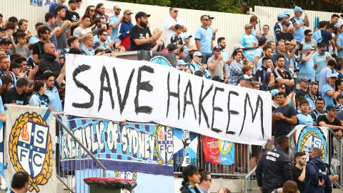 Sydney FC fans display a sign in support for Hakeem al-Araibi during  a match between Sydney FC and the Newcastle Jets.