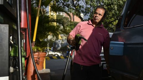 A man pumps fuel at a gas station in Caracas on January 29. A day earlier, the United States announced sanctions against Venezuela's state oil company, Petroleos de Venezuela, S.A.