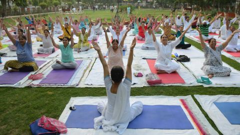 Indian yoga practitioners take part in a yoga session ahead of International Yoga Day at a park in Amritsar on June 20, 2018. - Yoga, which means union in Sanskrit, is a family of ancient spiritual practices and also a school of spiritual thought from South Asia, where it remains a vibrant living tradition and is seen as a means of enlightenment. (Photo by NARINDER NANU / AFP)        (Photo credit should read NARINDER NANU/AFP/Getty Images)