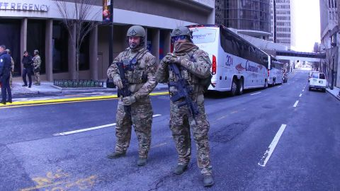 Department of Homeland Security agents guard the streets near the hotel hosting the New England Patriots.