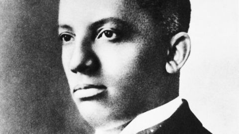 Carter G. Woodson, an African-American historian, wrote black Americans into US history