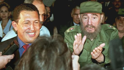 Venezuela's then-president-elect Hugo Chavez, flanked by then-Cuban leader Fidel Castro at the Jose Marti airport in Havana in 1999.