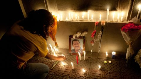 Supporters of  Chavez light candles in front of the Venezuelan Embassy  in Santiago, Chile, in 2013.