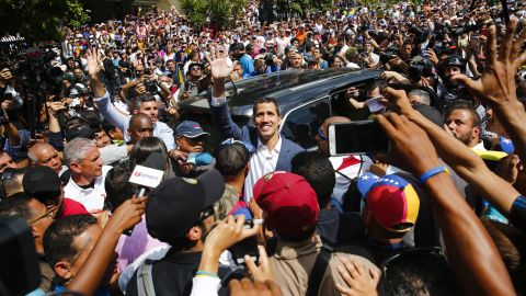 Guaido waves to supporters during the rally in Caracas on February 2.