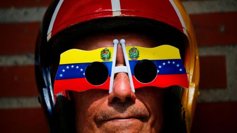 An anti-government protester wears glasses with a Venezuelan flag motif at the demonstration in Caracas on February 2.