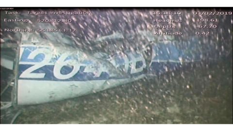 In this image released Monday Feb. 4, 2019, by the UK Air Accidents Investigation Branch (AAIB) showing the rear left side of the fuselage including part of the aircraft registration N264DB that went missing carrying soccer player Emiliano Sala, when it disappeared from radar contact on Jan. 21 2019.  The Air accident investigators say one body is visible in the sea in the wreckage of the plane that went missing carrying soccer player Emiliano Sala and his pilot David Ibbotson. (AAIB via AP)