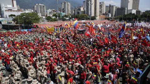 Thousands of public employees and government supporters gather in Caracas, Venezuela, Saturday, Feb. 2, 2019.