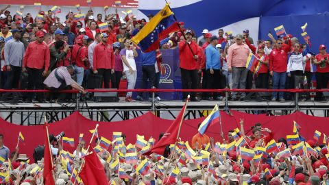 Venezuela's President Nicolas Maduro waves a national flag during a rally in Caracas, Venezuela, Saturday, Feb. 2, 2019.