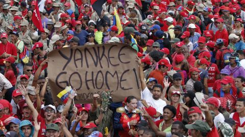 Supporters of President Nicolas Maduro hold up an anti-American banner during a rally in Caracas, Venezuela, Saturday, Feb. 2, 2019.