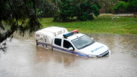 A police car is seen partially submerged in a drain after being swamped by flood waters on February 05, 2019 in Townsville, Australia.