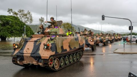 Army vehicles enter Townsville to help evacuate flood-affected people on February 4, 2019.