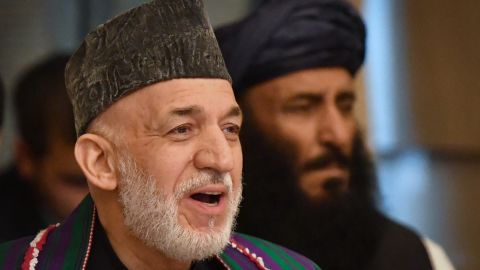 Former Afghan President Hamid Karzai attends the opening Tuesday of the two-day talks in Moscow.