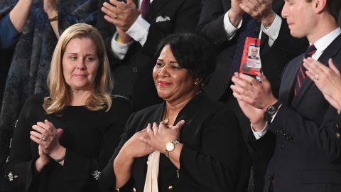 Alice Johnson (C), one of the US President's special guests, reacts as the president acknowledges her during his State of the Union address at the US Capitol in Washington, DC, on February 5, 2019. (Photo by SAUL LOEB / AFP)        (Photo credit should read SAUL LOEB/AFP/Getty Images)