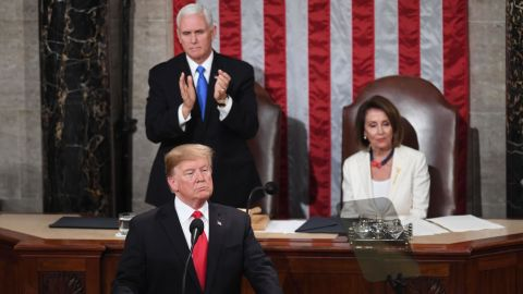 US Vice President Mike Pence (L) stands to applaud as he and Speaker of the US House of Representatives Nancy Pelosi (R) listen to US President Donald Trump deliver the State of the Union address at the US Capitol in Washington, DC, on February 5, 2019. (Photo by SAUL LOEB / AFP)        (Photo credit should read SAUL LOEB/AFP/Getty Images)