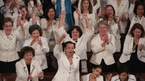 WASHINGTON, DC - FEBRUARY 05:  Female lawmakers cheer during President Donald Trump's State of the Union address in the chamber of the U.S. House of Representatives at the U.S. Capitol Building on February 5, 2019 in Washington, DC. A group of female Democratic lawmakers chose to wear white to the speech in solidarity with women and a nod to the suffragette movement.  (Photo by Alex Wong/Getty Images)