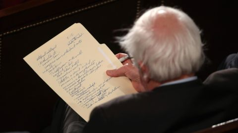 Sanders looks at his notes as he watches President Trump deliver the State of the Union address in February 2019. That month, Sanders announced that he would be running for president again.