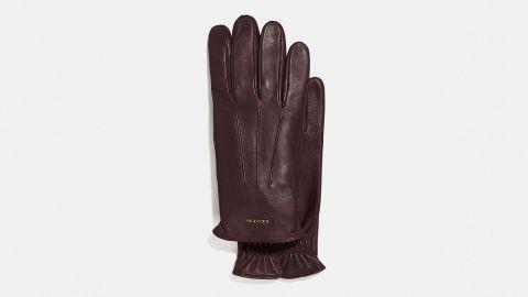 """<strong>Coach Tech Napa Glove ($75; </strong><a href=""""https://click.linksynergy.com/deeplink?id=Fr/49/7rhGg&mid=37299&u1=0219vdaygiftguide &murl=https%3A%2F%2Fwww.coach.com%2Fcoach-tech-napa-glove%2F33083.html%3Fcgid%3Dmen-accessories-scarves%26dwvar_color%3DMAH%23cgid%3Dmen-accessories-scarves%26start%3D1"""" target=""""_blank"""" target=""""_blank""""><strong>coach.com</strong></a><strong>) </strong>"""