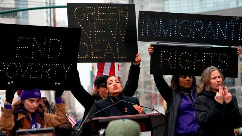 """""""Green New Deal"""" has become a rallying cry for many, including Alexandria Ocasio-Cortez, here at a 2019 Women's March rally."""