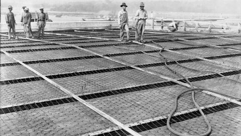 In the New Deal, unemployed workers were given jobs in public works projects like this one to build the Wilson Dam across the Tennessee River.