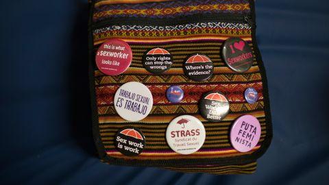 Sex worker buttons decorate Foxxy Angel's handbag.