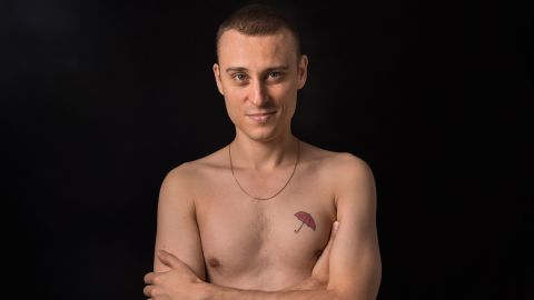 Thierry Shaffauser, 36, displays his red umbrella tattoo, a symbol for sex workers' rights.