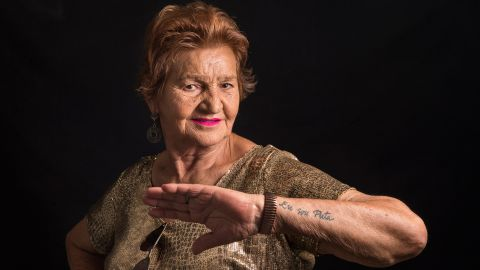 """Maria De Lourdes Araujo, 76, of Barreto, Brazil, shows off her """"I am a whore"""" tattoo. The sex work industry used to be filled with passion and glamour, she says, with dancing often used as a means of seduction. Today, the great-grandmother continues to see regular clients.<br />"""