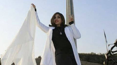 Women in Iran have been protesting the obligatory Islamic headscarf by taking theirs off and waving them on sticks.