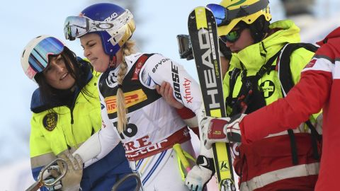Lindsey Vonn is helped after crashing out of the penultimate race of her career in the super-G event at the World Championships in Are.