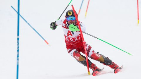 Marcel Hirscher focuses as he slides past the poles during the slalom.