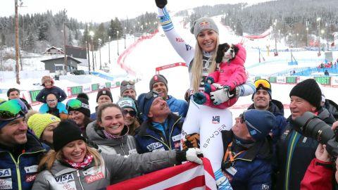 Vonn celebrates winning World Championship bronze in the downhill in her final race before retirement.