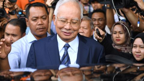 Former Malaysian Prime Minister Najib Razak leaves the courthouse in Kuala Lumpur on December 12, 2018 after being charged with multiple counts of corruption.