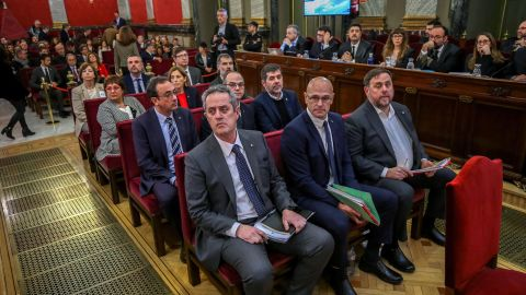 Former Catalan separatist leaders including (from front row R-L) Oriol Junqueras, Raul Romeva, Joaquim Forn, Jordi Sanchez, Jordi Turull, Josep Rull, Jordi Cuixart, Carme Forcadell, Dolors Bassa, Carles Mundo, Santi Vila and Meritxel Borras attend their trial at the Supreme Court in Madrid on February 12, 2019. - Twelve former Catalan leaders go on trial at Spain's Supreme Court for their role in a failed 2017 bid to break away from Spain. (Photo by Emilio Naranjo / POOL / AFP)        (Photo credit should read EMILIO NARANJO/AFP/Getty Images)