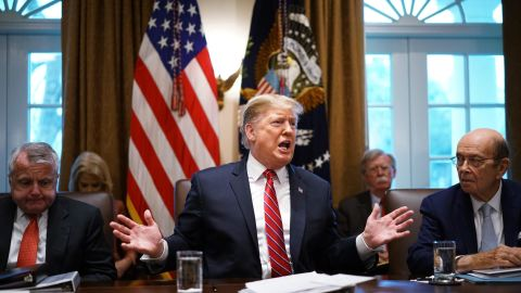 """US President Donald Trump speaks during a cabinet meeting in the Cabinet Room of the White House in Washington, DC on February 12, 2019,as Deputy Secretary of State John Sullivan (L) and Commerce Secretary Wilbur Ross(R) look on. - US President Donald Trump said Tuesday he would consider extending the deadline for a trade deal with China beyond March 1. """"If we're close to a deal ... I could see myself letting that slide for a little while,"""" Trump said at the White House. (Photo by MANDEL NGAN / AFP)        (Photo credit should read MANDEL NGAN/AFP/Getty Images)"""
