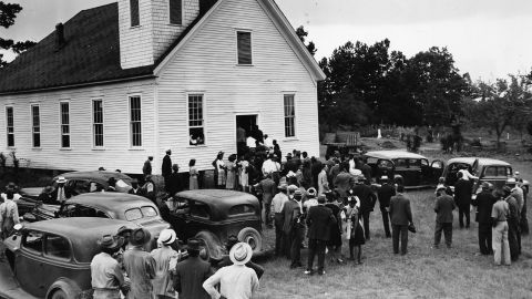 Mourners gather at a church near Monroe, Georgia, in 1946 for the funerals of four black sharecroppers.