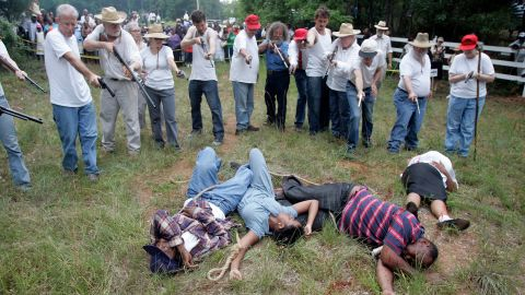 Activists seeking justice for years re-enacted the brutal slayings at the hands of an angry white mob.